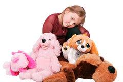 Meisje en gevulde dieren stock afbeeldingen