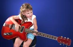Meisje en gitaar Stock Afbeelding