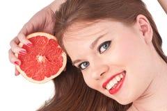 Meisje en grapefruit Royalty-vrije Stock Fotografie