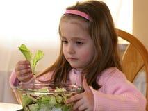 Meisje en groenten 3 stock afbeelding