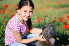 Meisje en haar hond Stock Afbeelding