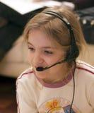 Meisje en hoofdtelefoon Stock Foto
