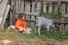 Meisje en jong geitje Royalty-vrije Stock Afbeelding