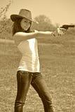 Meisje en pistool Stock Fotografie