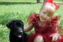 Meisje en puppy Royalty-vrije Stock Foto's