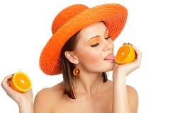 Meisje en sinaasappelen Royalty-vrije Stock Afbeeldingen