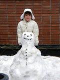 Meisje en sneeuwman Stock Fotografie