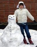 Meisje en sneeuwman Stock Foto
