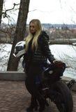 Meisje en sportmotor Stock Foto