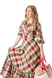 Meisje in gecontroleerde kleding Royalty-vrije Stock Afbeeldingen