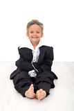 Meisje in grote bedrijfskleren Stock Foto's