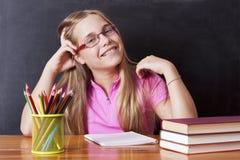 Meisje het bestuderen stock fotografie