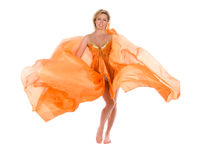 Meisje in het oranje kleding vliegen Stock Foto's
