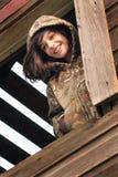 Meisje in het venster royalty-vrije stock fotografie