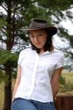 Meisje in Hoed stock foto's