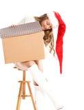 Meisje in Hoed Canta met een gift Stock Afbeelding