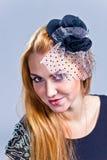 Meisje in hoed met sluier Stock Foto