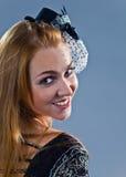 Meisje in hoed met sluier Stock Afbeeldingen