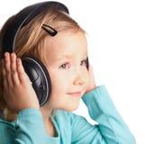 Meisje in hoofdtelefoons stock afbeelding