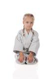 Meisje - karateka in kimono Stock Afbeelding