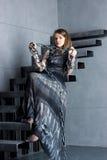 Meisje in kledingszitting royalty-vrije stock foto's