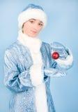 Meisje in kostuum met nieuw jaarspeelgoed Stock Afbeelding