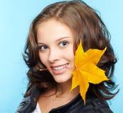 Meisje in leerjasje Stock Foto's