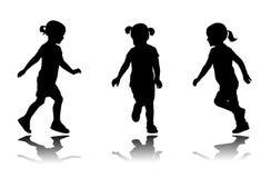 Meisje lopende silhouetten Stock Foto's