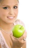 Meisje met appel Stock Foto's