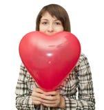 Meisje met ballon in de vorm van hart Stock Fotografie