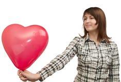 Meisje met ballon in de vorm van hart Stock Foto