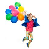 Meisje met ballons het springen Royalty-vrije Stock Afbeelding