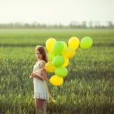 Meisje met baloons Stock Foto's
