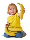 Meisje met banaan dat op wit wordt geïsoleerdj Stock Afbeeldingen