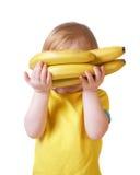 Meisje met banaan dat op wit wordt geïsoleerdp Stock Foto's
