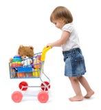 Meisje met boodschappenwagentje Stock Foto