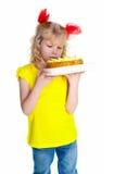 Meisje met cake. Geïsoleerd op witte achtergrond Stock Foto