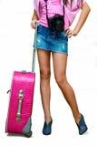Meisje met camera en koffer stock fotografie