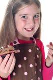 Meisje met chocolade cupcakes royalty-vrije stock foto