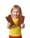 Meisje met chocolade dat op wit wordt geïsoleerdb Stock Foto