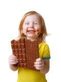 Meisje met chocolade dat op wit wordt geïsoleerdT Stock Foto's