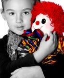 Meisje met clown Stock Afbeeldingen