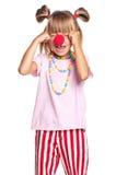 Meisje met clownneus stock afbeelding