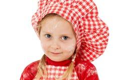 Meisje met de close-up van de chef-kokhoed Stock Foto