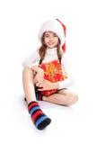 Meisje met de hoed van santa Stock Foto