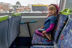 Meisje met een autoped op trein royalty-vrije stock afbeelding