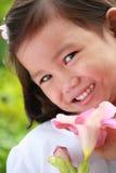 Meisje met een bloem stock foto's