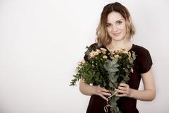 Meisje met een boeket Royalty-vrije Stock Afbeelding