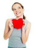Meisje met een hart-vormig hoofdkussen Royalty-vrije Stock Afbeeldingen