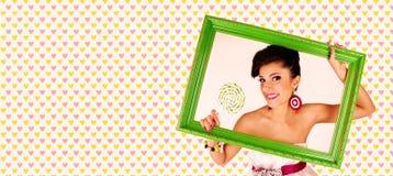 Meisje met een kader royalty-vrije stock fotografie